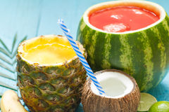 Exotic freshly squeezed juice with pineapple, watermelon and coconut Stock Image