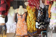 Exotic, frilly and garish frocks at Pattaya Thailand. Dresses on mannequins at shop in Pattaya Royalty Free Stock Photos