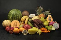 Exotic fruit arrangement on black background. With waterdrops Stock Images