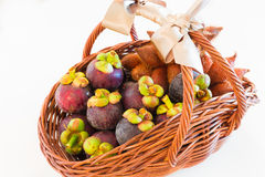 An exotic fruit basket of mangosteen and zalacca perfect idea fo Stock Photos