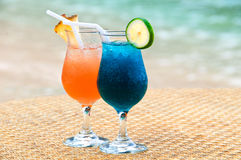 Exotic fruit cocktails at the sandy beach Royalty Free Stock Image