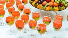 Exotic Fruit Dish with Mint Jelly. Dragon Fruit, Maracuya, Starfruit, Cantaloupe and Berries Royalty Free Stock Images