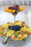 Exotic Fruit Dish with Mint Jelly. Dragon Fruit, Maracuya, Starfruit, Cantaloupe and Berries Stock Photo