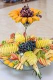 Exotic Fruit Dish with Mint Jelly. Dragon Fruit, Maracuya, Starfruit, Cantaloupe and Berries Stock Image
