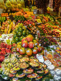 Exotic fruit. A lot of colored exotic fruit in a local market of spain Stock Photos