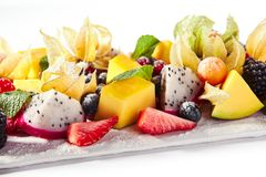 Free Exotic Fruit Plate Or Vegan Platter With Sliced Fruits And Berries Stock Photo - 157007620