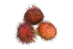 Exotic Fruit - Rambutan. Three Rambutan  on White Stock Photos