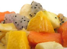 Exotic fruit salad. Fruit salad containing dragon fruit, star fruit, mango, orange, papaya and apples Royalty Free Stock Images