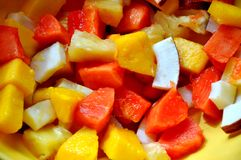 Exotic fruit salad : coconut, papaya, mango royalty free stock photos