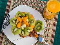 Exotic fruit salad in the orange skin.Top view Royalty Free Stock Photo