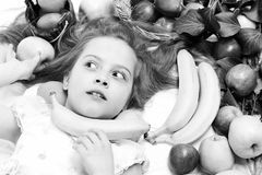 Exotic fruit or summer background with small surprised girl. stock image