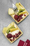 Exotic Fruit Tarts on a rustic background Royalty Free Stock Images