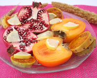 Exotic fruits. Some pieces of pomegranate, khaki, figs and lemon Royalty Free Stock Image