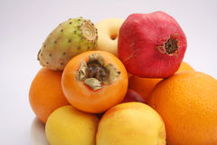 Exotic fruits. Some fresh exotic fruits, figs, khaki, oranges and pomegranate royalty free stock photography