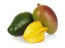 Exotic fruits. Mango, avocado and carambola on white background Stock Photography