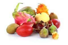 Exotic fruits. Mangosteen, fig, mango, Asian pear, dragon fruit, horned melon, tamarillo stock images