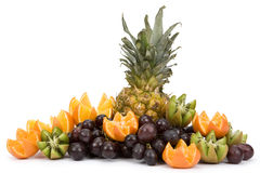 Exotic fruits. Stack of exotic fruits on white background. There are oranges, grapes, kiwi, pineapple Royalty Free Stock Images