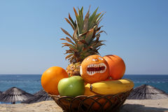 Exotic Fruits Against Tropical Beach. Basket of fresh fruits, with tropical beach in the background Stock Photography