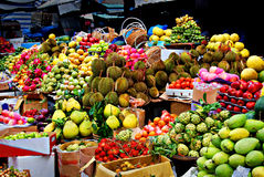 Exotic fruits, asian market. Asian market, exotic fruits, such as mangos, melons, bananas, apples and durians, traditional marketplace in Vietnam and Thailand royalty free stock images