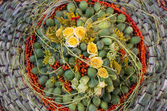 Exotic fruits in basket. Exotic fruits in a basket with roses stock photos