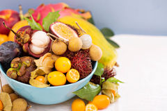 Exotic fruits in a blue bowl Stock Photography