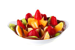 Exotic fruits in chocolate Stock Photography