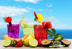 Exotic fruits cocktail over skye background Royalty Free Stock Photography