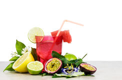 Exotic fruits cocktail over white background Royalty Free Stock Photos