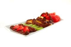 Exotic fruits in cream Stock Photos