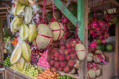 The exotic of fruits hang and lie at the kiosk Singapore trader Royalty Free Stock Photos
