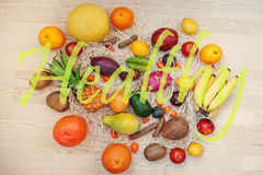 Exotic fruits with healthy sign. Healthy eating dieting food bac Stock Image