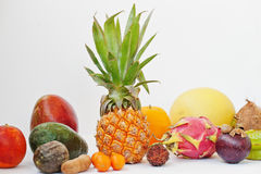 Exotic fruits isolated on white background. Healthy eating dieti. Ng food. Pitahaya, carambola, papaya, baby pineapple, mango, passion fruit, tamarind and other Stock Photos