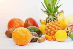 Exotic fruits isolated on white background. Healthy eating dieti. Ng food. Pitahaya, carambola, papaya, baby pineapple, mango, passion fruit, tamarind and other Royalty Free Stock Photos