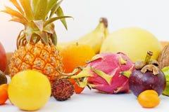 Exotic fruits isolated on white background. Healthy eating dieti. Ng food. Pitahaya, carambola, papaya, baby pineapple, mango, passion fruit, tamarind and other Stock Image