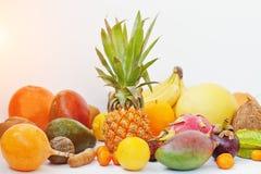 Exotic fruits isolated on white background. Healthy eating dieti. Ng food. Pitahaya, carambola, papaya, baby pineapple, mango, passion fruit, tamarind and other Royalty Free Stock Photo