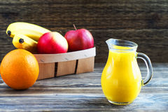 Exotic fruits and juice in glass jug stock image