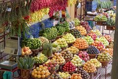Exotic fruits in a market Mercado dos Lavradores, Funchal, Madeira. Exotic fruits on famous market in Funchal Mercado dos Lavradores, Portuguese island of stock photo