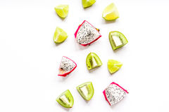 Exotic fruits pattern with kiwi, pitaya isolated white background top view mockup Royalty Free Stock Photos