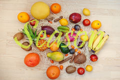 Exotic fruits with season sign. Healthy eating dieting food back Stock Photo