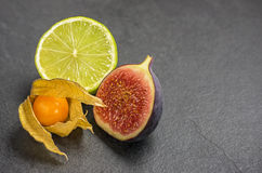 Exotic fruits on slate plate Stock Images