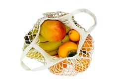 Exotic fruits in white mesh net bag and isolated on white background.  royalty free stock photos