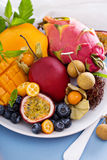 Exotic fruits on white plate Stock Photo