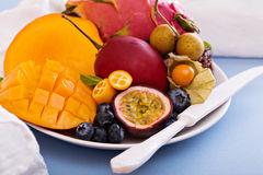 Exotic fruits on white plate Stock Image