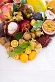 Exotic fruits on white table Stock Photography
