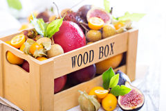 Exotic fruits in a wooden crate Royalty Free Stock Image