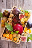 Exotic fruits in a wooden crate. Variety of exotic fruits in a wooden crate royalty free stock images