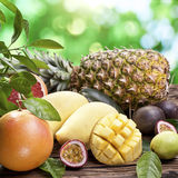 Exotic fruits on a wooden table. Royalty Free Stock Photos