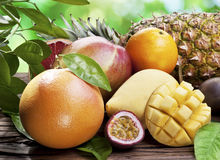 Exotic fruits on a wooden table. royalty free stock images