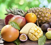 Exotic fruits on a wooden table. Royalty Free Stock Image