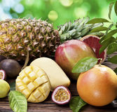 Exotic fruits on a wooden table. Royalty Free Stock Photo